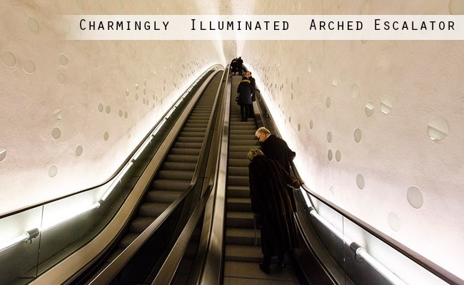 charmingly-illuminated-arched-escalators